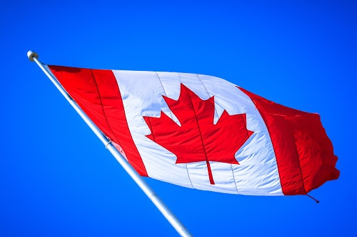 Canadian flag waving in the wind.