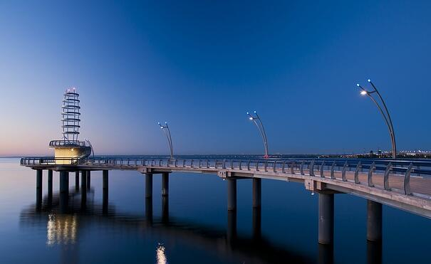 The street lights were perfectly in sync with the beautiful long bridge.
