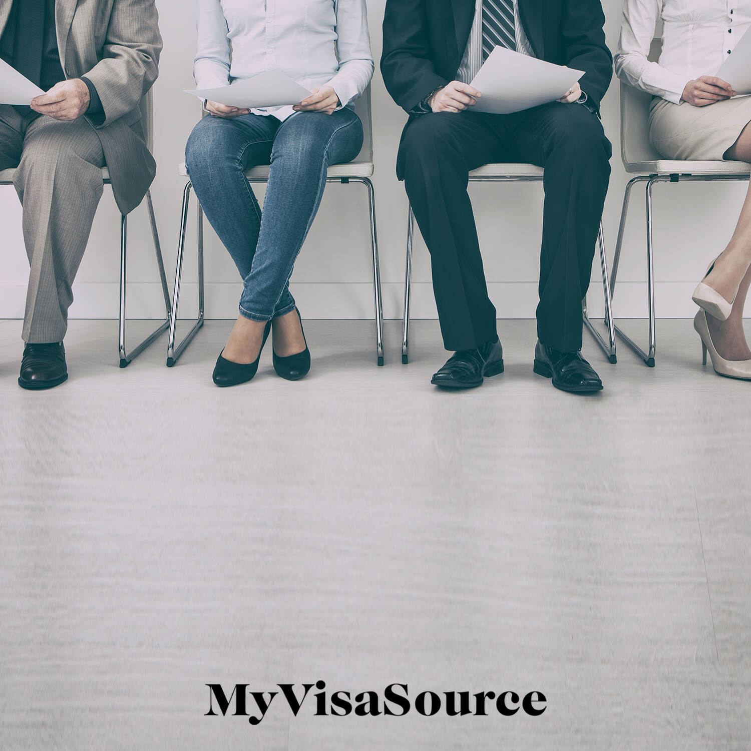 4 people sitting in chairs waiting with resumes in hand my visa source