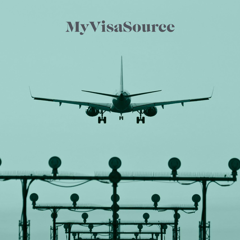 airplane above set of signal lights my visa source