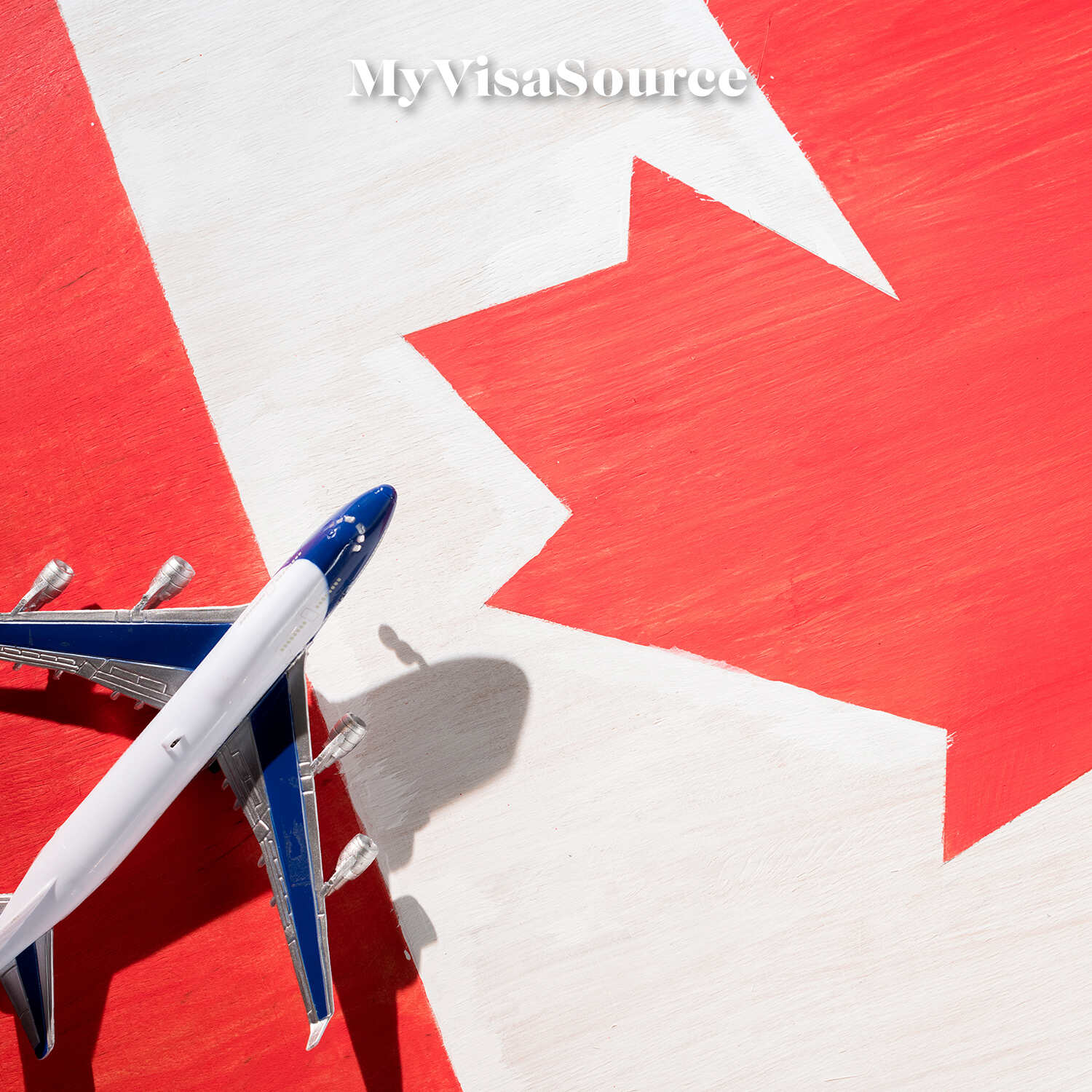 airplane-over-canadian-flag-my-visa-source