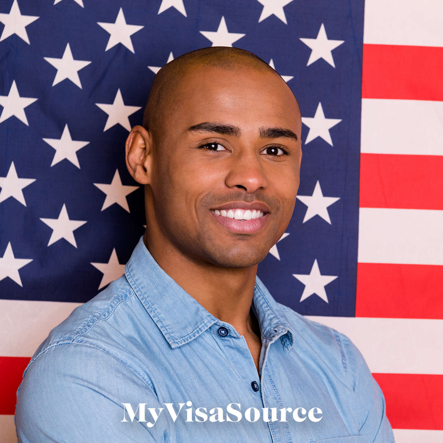 black man smiling standing in front of usa flag my visa source