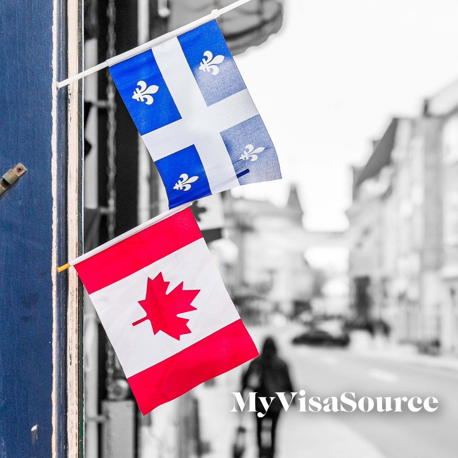 canadian and quebec flags on storefront my visa source