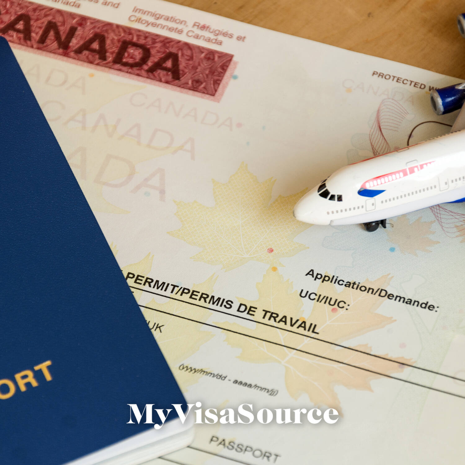 close up of a canadian visa and toy airplane my visa source