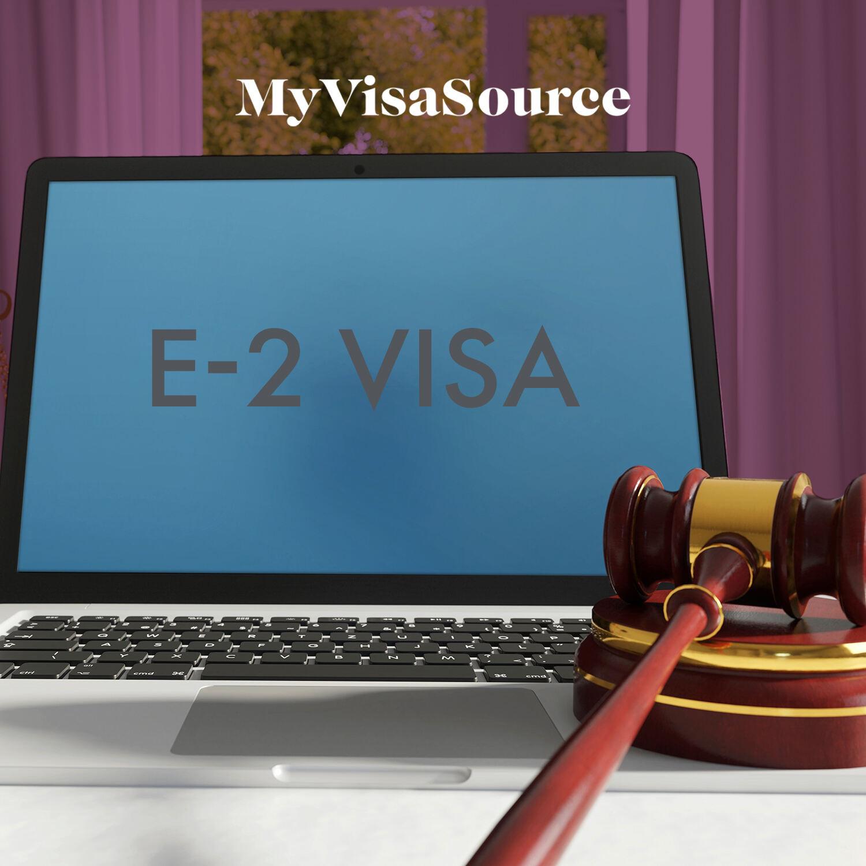 e 2 visa on laptop display and judge gavel beside it my visa source
