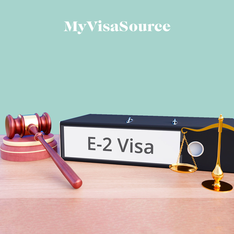 e 2 visa written on a box with a gavel my visa source
