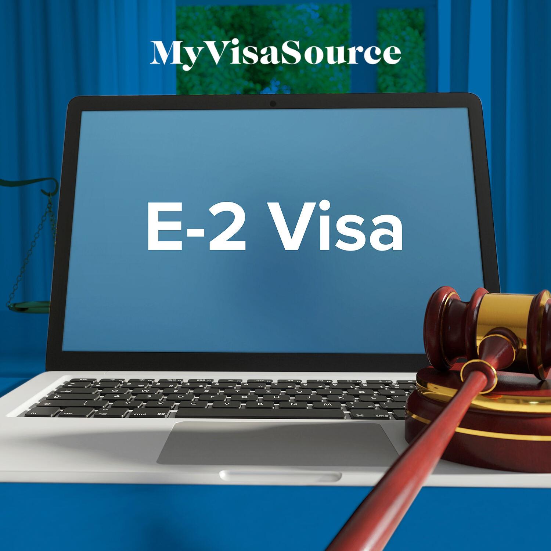 e 2 visa written on a laptop gavel nearby my visa source