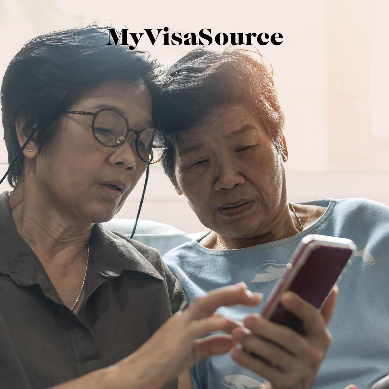 elderly asian women conversing my visa source