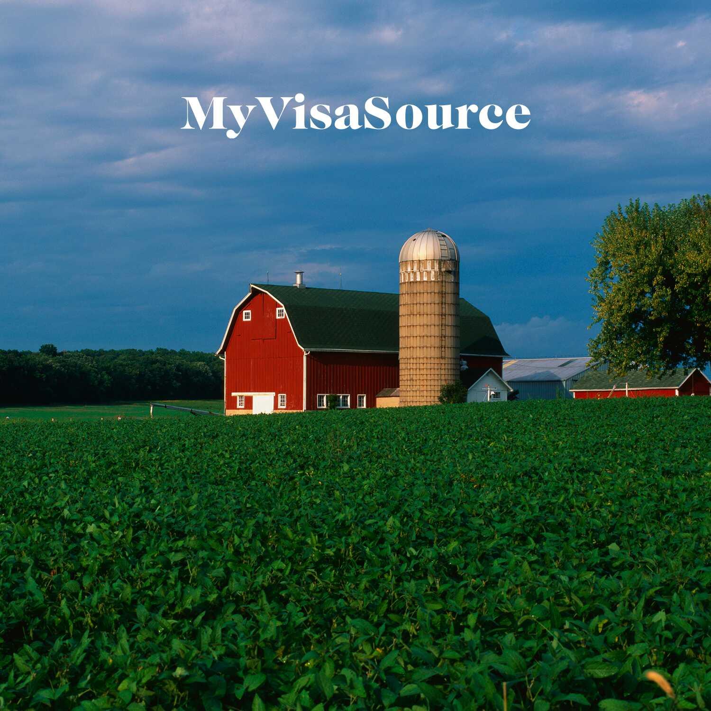 farm-house-and-silo-on-farmland-my-visa-source