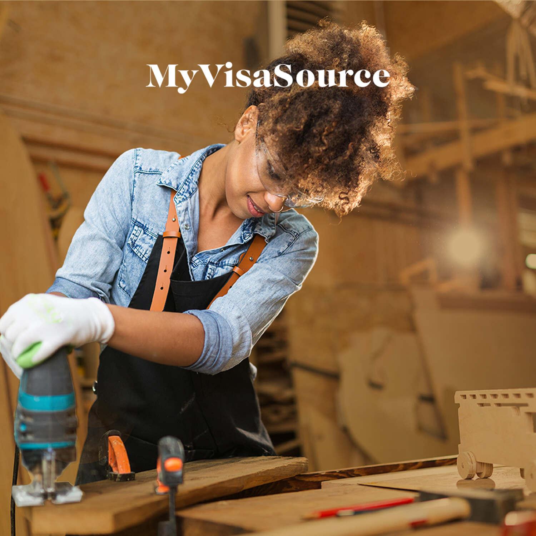 female-tradespfemale tradesperson working with a wood saw my visa sourceerson-working-with-a-wood-saw-my-visa-source-200kb