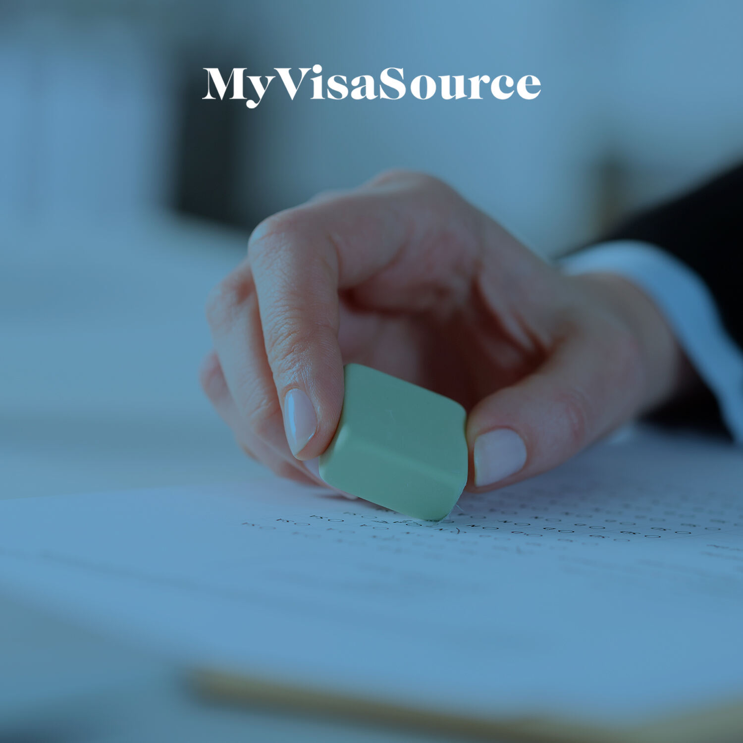 hand holding an eraser changing a document my visa source
