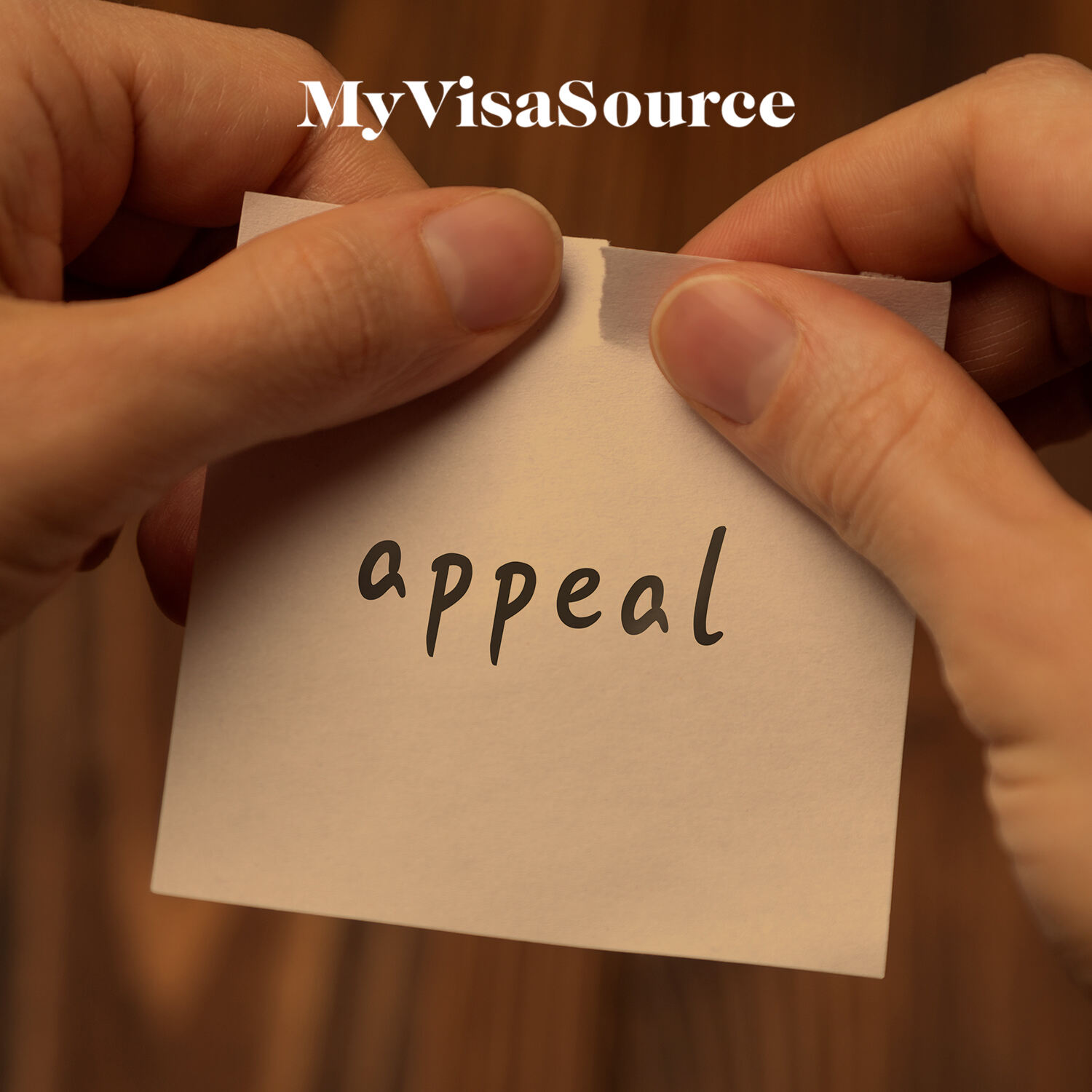 hands tearing paper with appeal written my visa source