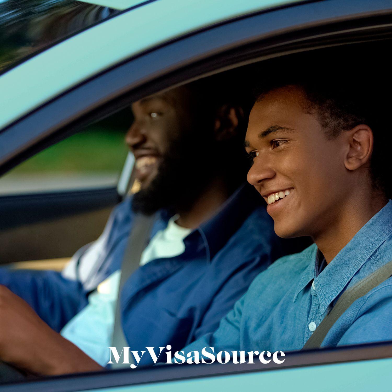 happy young man driving my visa source