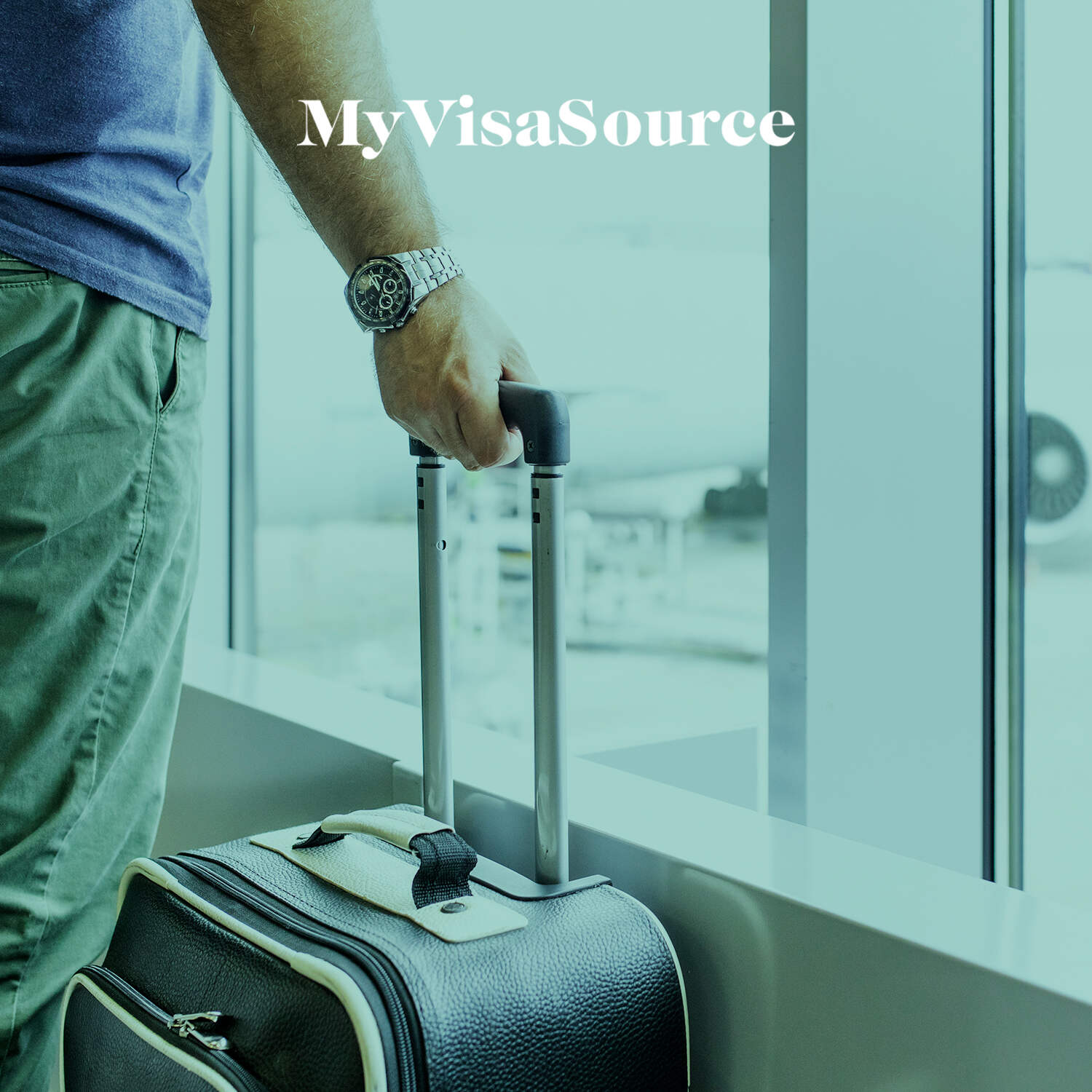 man holding handle of luggage waiting for his plane my visa source