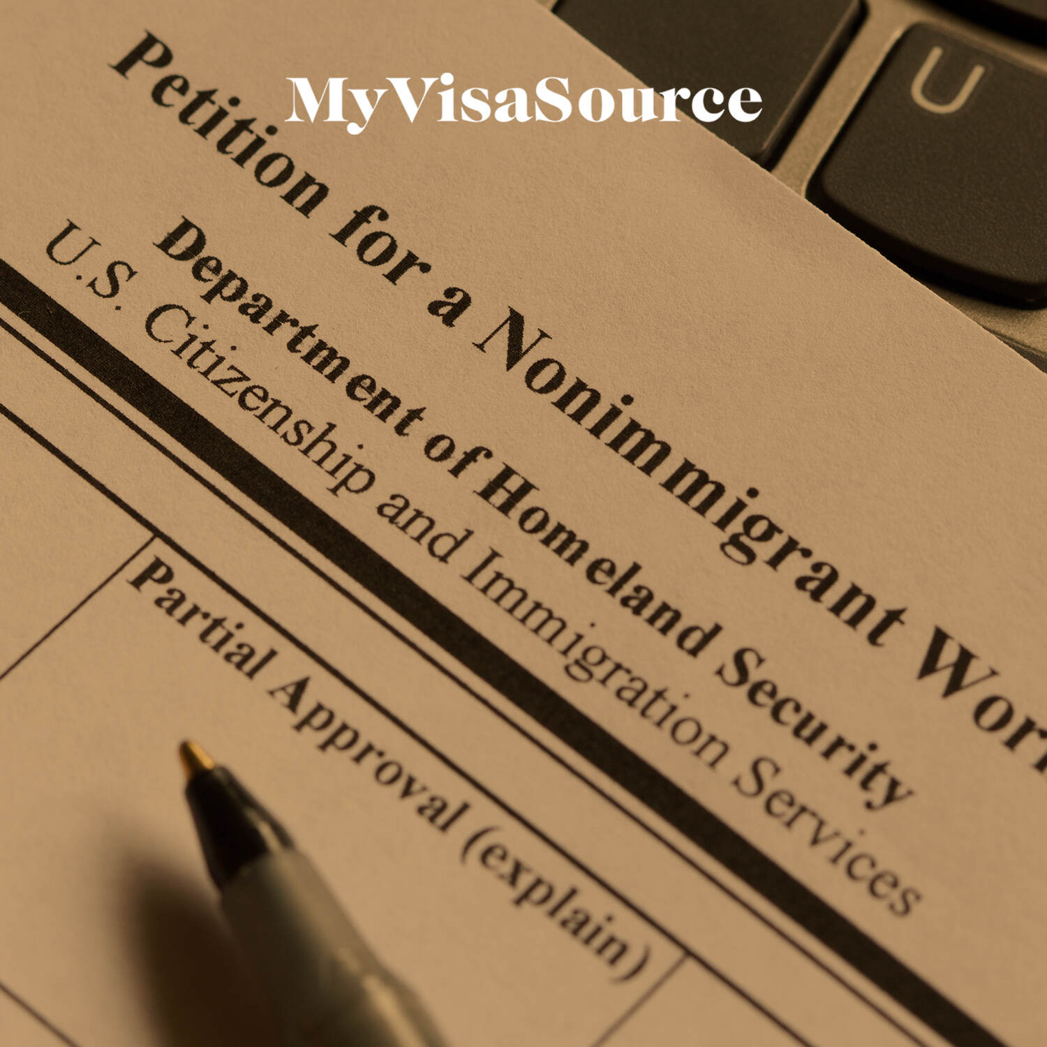 nonimmigrant work visa application with a pen resting on it my visa source