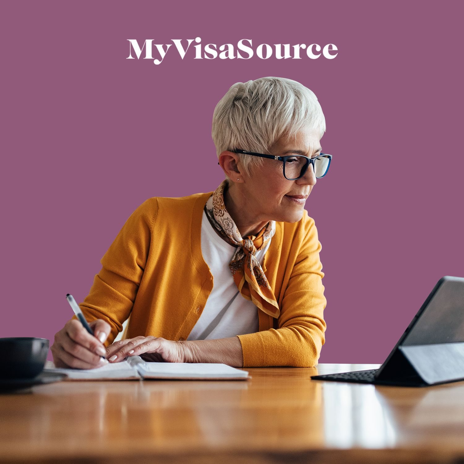 older professional woman taking notes from laptop my visa source