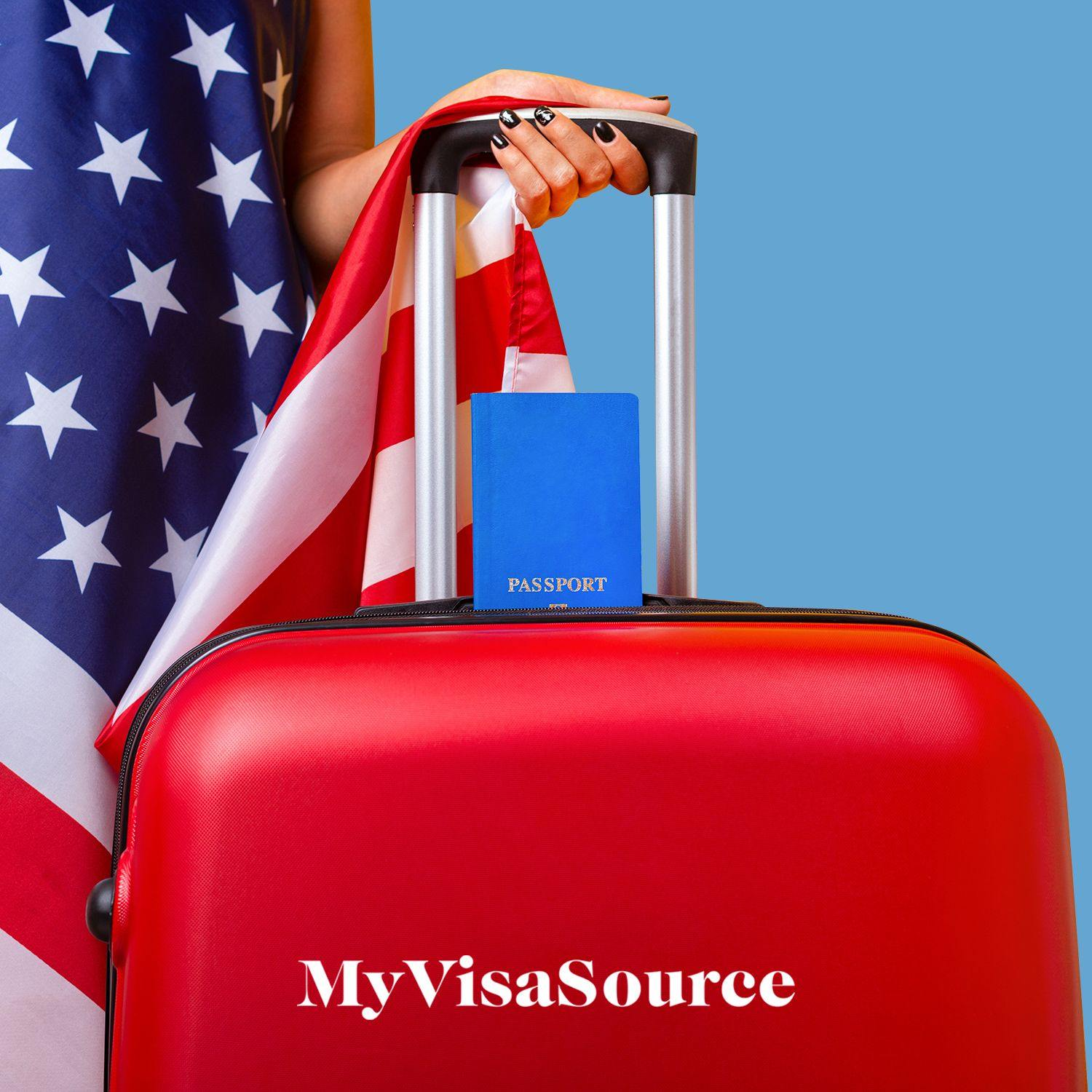 traveler with luggage and an american flag my visa source