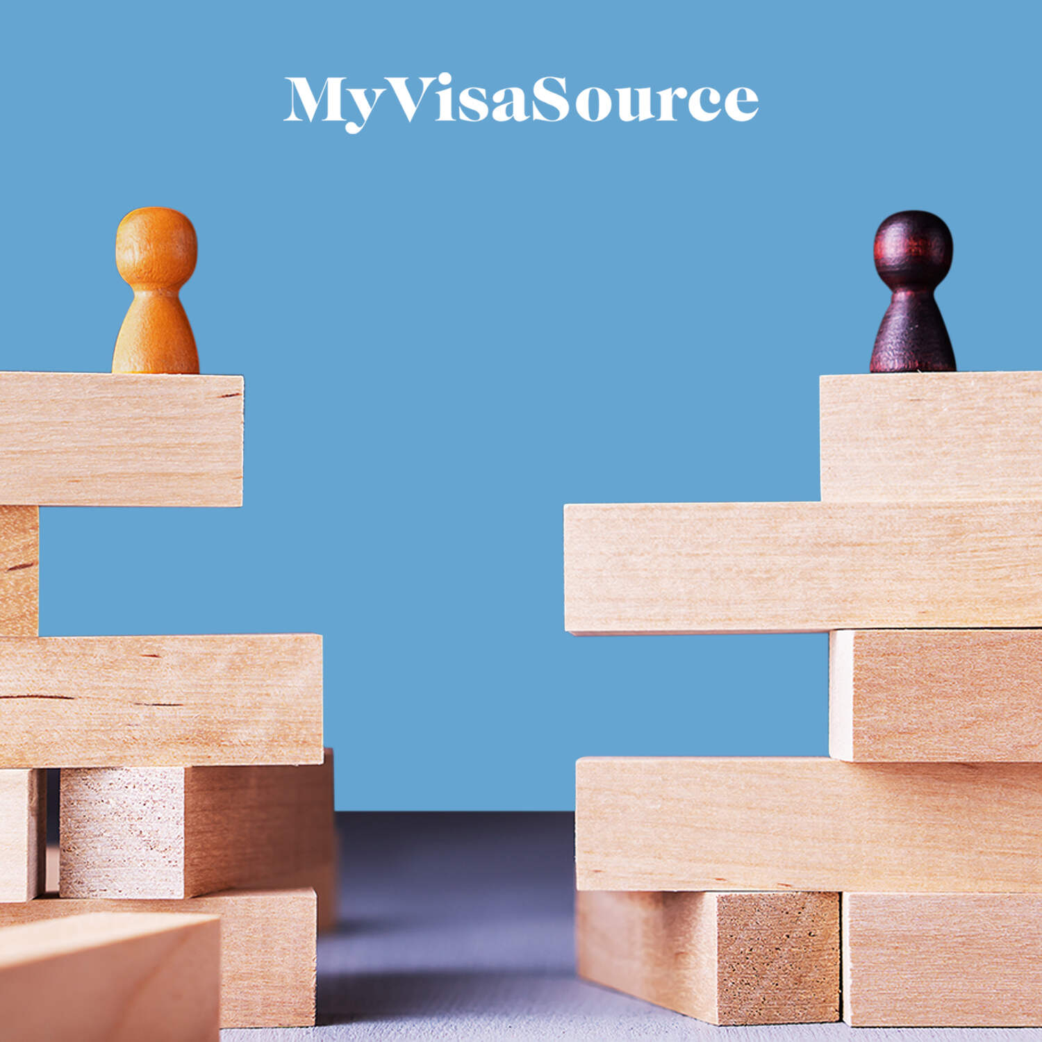 two wood figurines facing each other on top of blocks my visa source