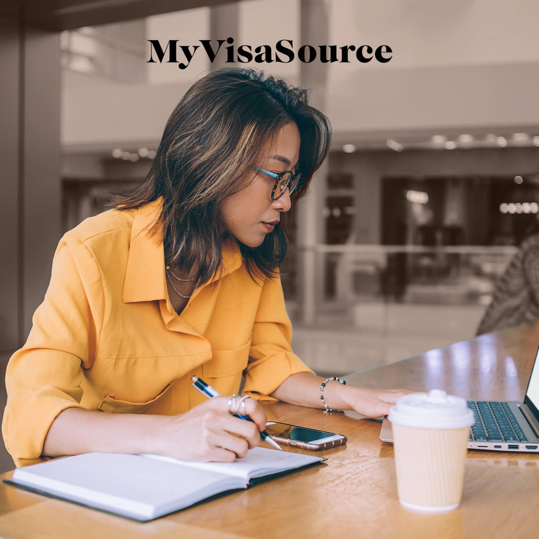 woman studying hard at coffeeshop my visa source