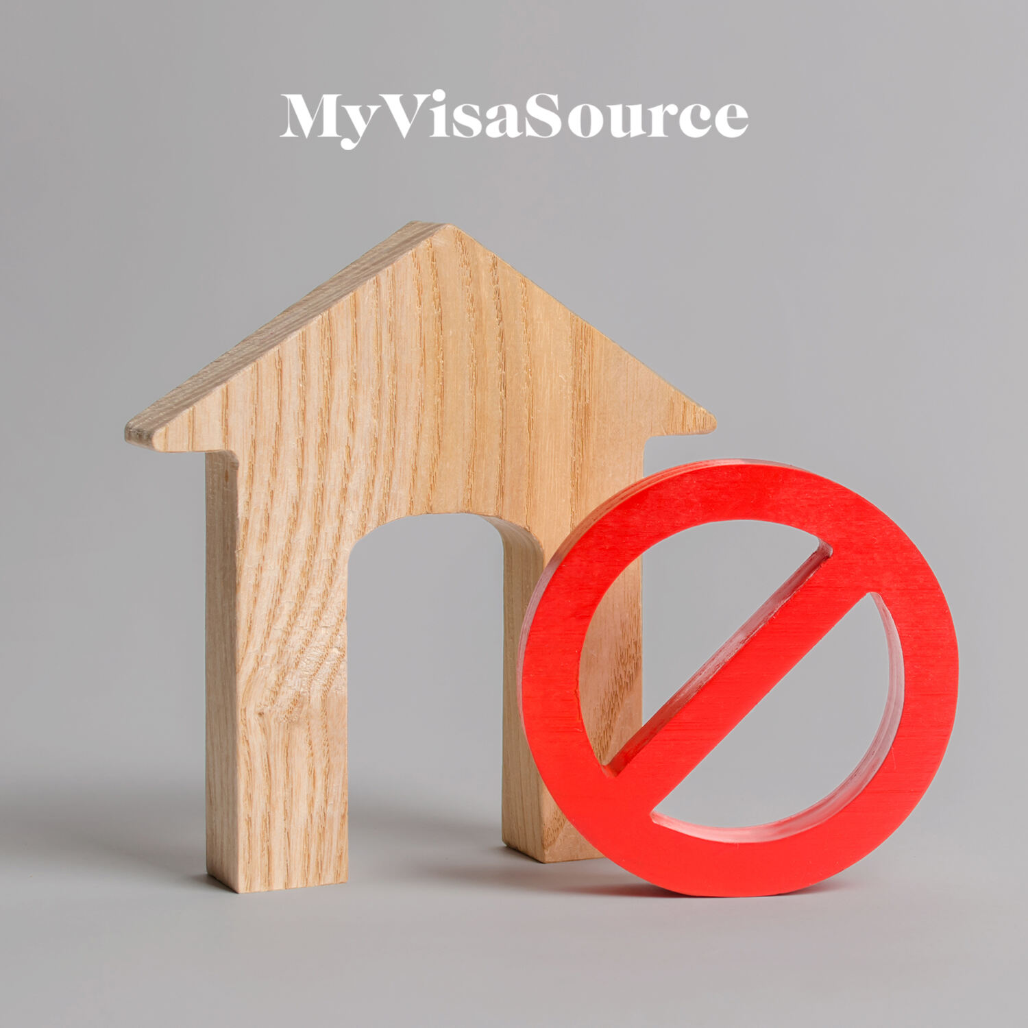 wooden house cutout with a red no symbol beside it