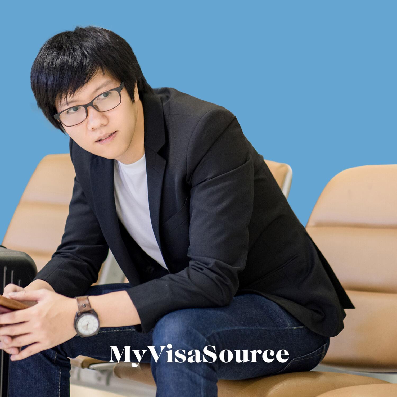 young asian man waiting at the airport