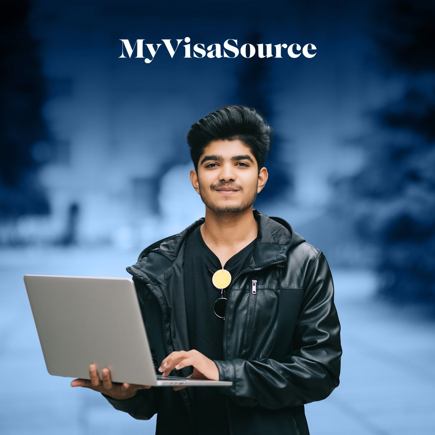 young east indian male student with a laptop smiling my visa source