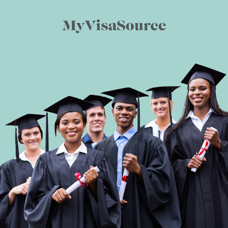 young graduates in graduation uniforms my visa source