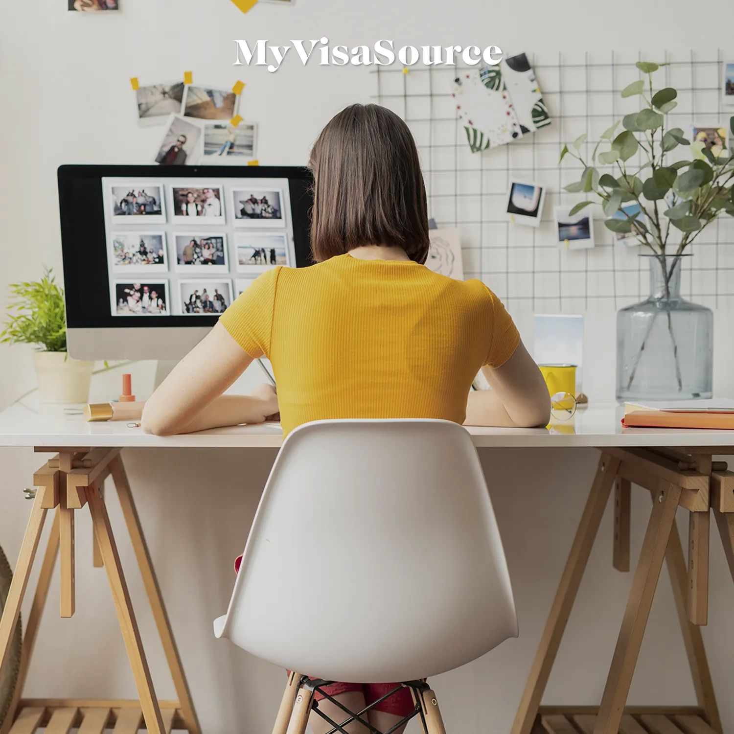 a-woman-working-at-her-desk-by-my-visa-source