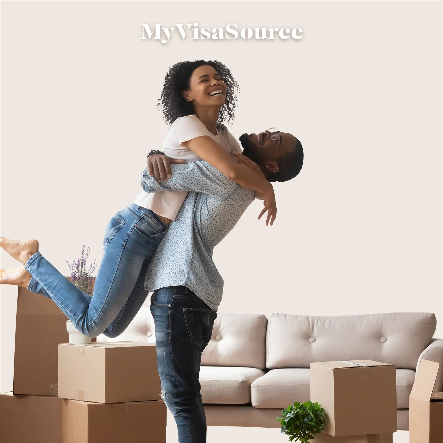 happy couple hugging after packing boxes to move with pink background by my visa source