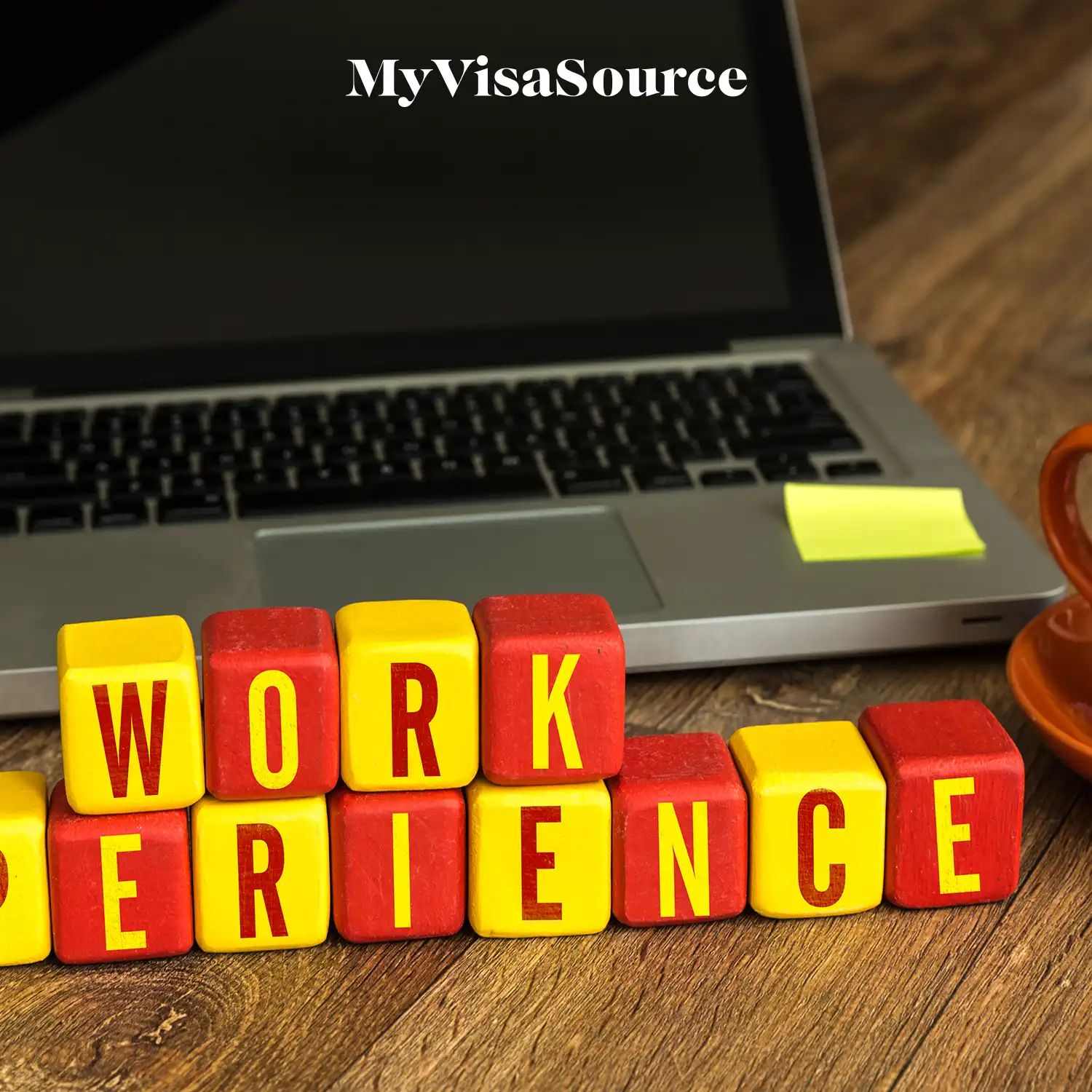 work experience spelled out in blocks in front of a laptop by my visa source