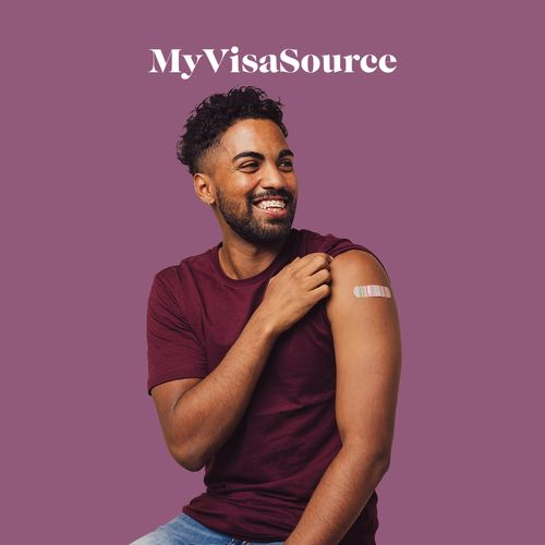 young man with vaccination bandaid on his arm my visa source